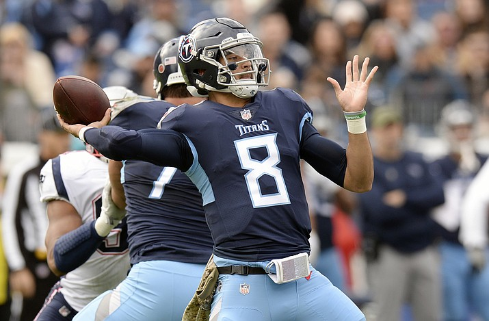 In this Nov. 11, 2018, file photo, Tennessee Titans quarterback Marcus Mariota throws a pass against the New England Patriots during the first half of an NFL football game in Nashville, Tenn. The Titans play the Houston Texans, who have won seven games in a row, Monday night. (Mark Zaleski/AP, File)