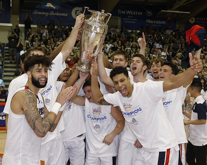 Gonzaga players hold the trophy after they defeated Duke 89-87 in an NCAA college basketball game to win the Maui Invitational, Wednesday, Nov. 21, 2018, in Lahaina, Hawaii. (Marco Garcia/AP)