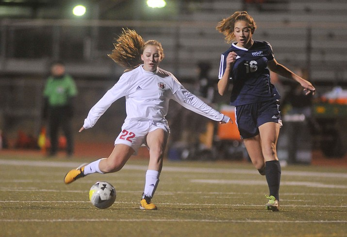 Bradshaw Mountain's Hayley Denman passes the ball as the Bears take on Higley in girls soccer Tuesday night in Prescott Valley. (Les Stukenberg/Courier)