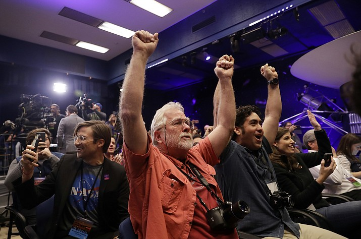 People at NASA's Jet Propulsion Laboratory in Pasadena, Calif., celebrate as the InSight lander touches down on Mars on Monday, Nov. 26, 2018. (Marcio Jose Sanchez/AP)