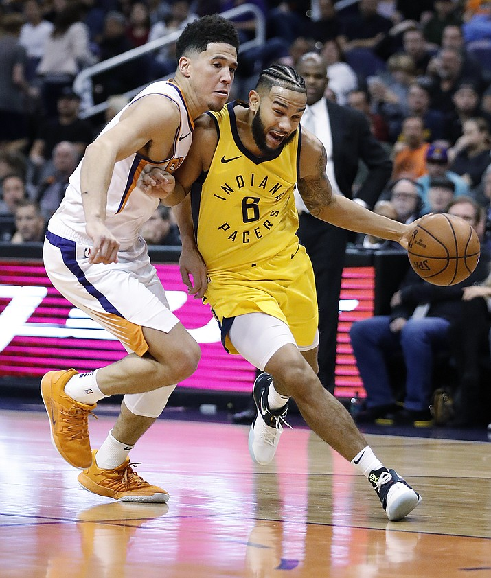 Indiana Pacers guard Cory Joseph (6) drives past Phoenix Suns guard Devin Booker during the first half of an NBA basketball game, Tuesday, Nov. 27, 2018, in Phoenix. (Matt York/AP)