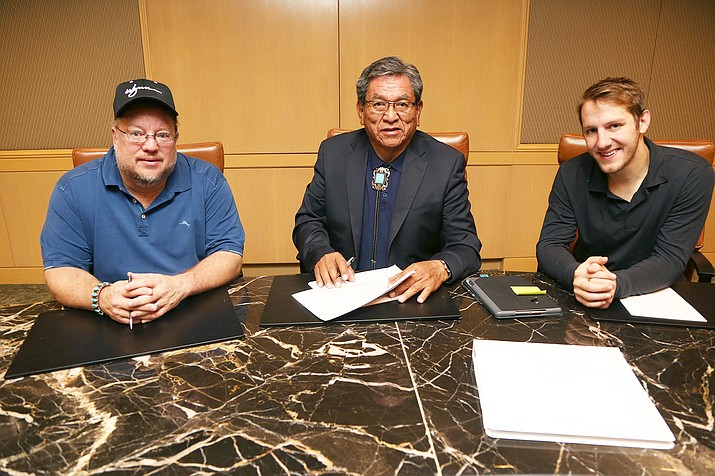President Russell Begaye (center) was joined by CKP Insurance owner Chuck Hemphill (left) and CKP Insurance agent Alex Greenstein as he renewed contracts for crop insurance.(Office of the President)