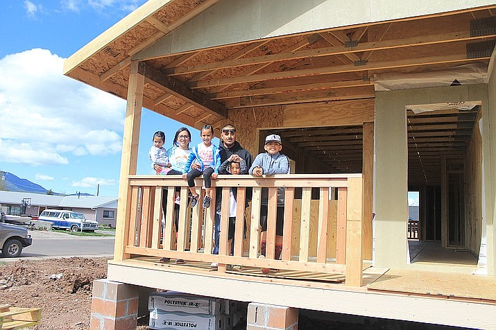 The Hernandez-Martinez family stand on the front porch of their Habitat for Humanity home in 2017. (Wendy Howell/WGCN)