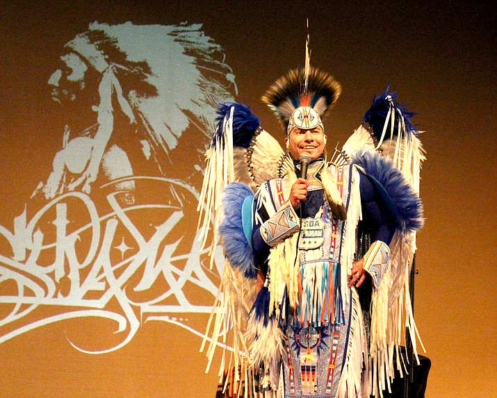 Christian Parrish Takes the Gun, also known as Supaman, tells jokes and funny stories for an audience in Page, Arizona. A hip-hop artist and pow wow dancer, Takes the Gun toured schools and performed for audiences Nov. 16 in Page in honor of Native American Heritage Month. (Kyla Rivas/NHO)