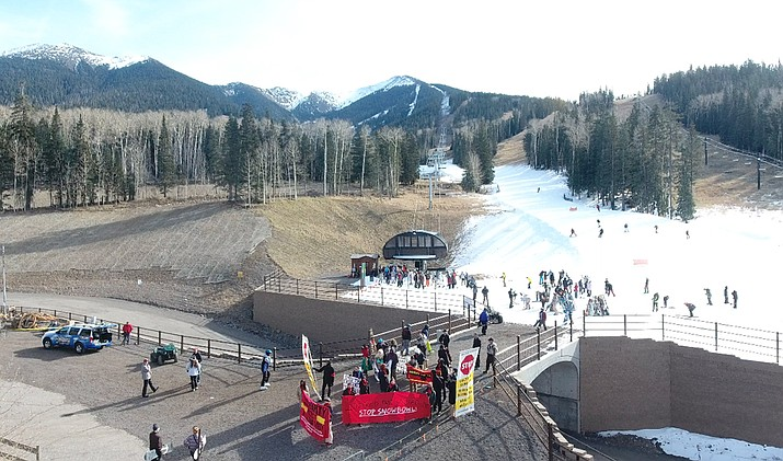 An aerial view of Snowbowl Nov. 16 shows man-made treated effluent on the mountain and the demonstration held by Protect the Peaks at the entrance to the chairlift. (Protect the Peaks)