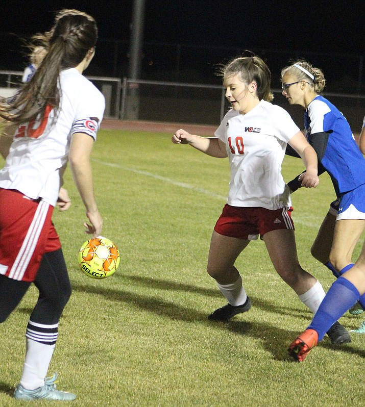 Mackenzie Cathey, 10, tallied a school-record seven goals Tuesday in Lee Williams' 13-2 win over Kingman High. (Photo by Beau Bearden/Daily Miner)