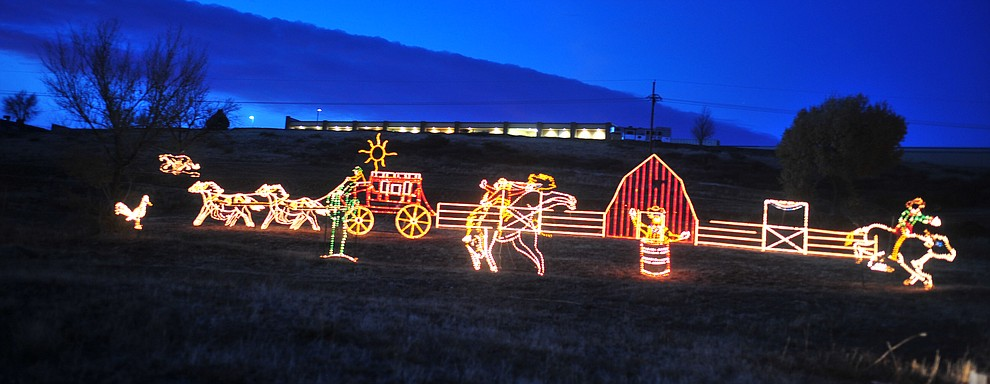 The Valley of Lights held their now annual stroll through Tuesday, Nov. 27, 2018 in Prescott Valley. The event allows people to walk through the display and for people to take their time seeing all the dsiplays while enjoying carolers and hot chocolate at various stops along the way. (Les Stukenberg/Courier).