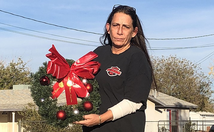"""Kelly Davis exhibits one of the wreaths at her home that will be placed Saturday.  """"This a huge honor considering where I've come from and now to be part of something so awesome,"""" Davis said. (Photo by Shawn Byrne/Daily Miner)"""