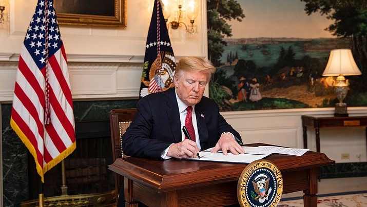 "President Donald Trump is seeking $5 billion for the wall, which he made a centerpiece of his 2016 campaign and said Mexico would pay for, and he is stepping up pressure on Congress to provide it. Trump said he would ""totally be willing"" to shut down the government if he doesn't receive the wall money he wants. (Official White House Photo by Joyce N. Boghosian)"