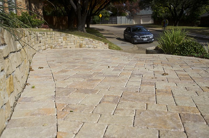 Stone pavers line a driveway in a residential neighborhood in Dallas. Many homeowners and communities are opting for permeable paving options instead of traditional asphalt. (Benny Snyder/AP)
