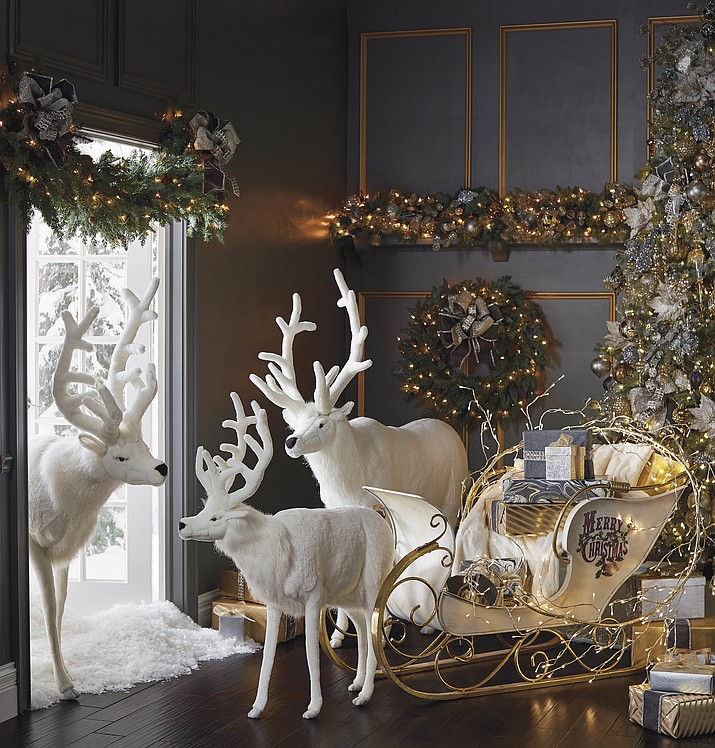 Life-sized mechanical reindeer from Frontgate might just be the topper on your holiday décor. Clad in snowy-white faux fur, the Hansa reindeer are meant for indoor use only. (Frontgate via AP)