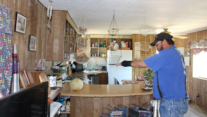 Len La Count shows the remodeled kitchen in his house that was funded by a grant through Mohave County Community Services. The county is holding a home maintenance workshop Wednesday for program participants. (Photo by Hubble Ray Smith/Daily Miner)