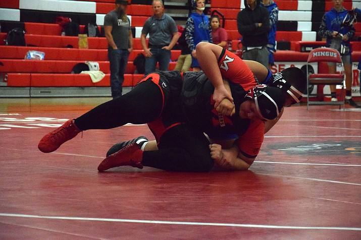 Mingus senior Danni Schulz wrestles against a boy from Snowflake in an exhibition on Wednesday at home. VVN/James Kelley