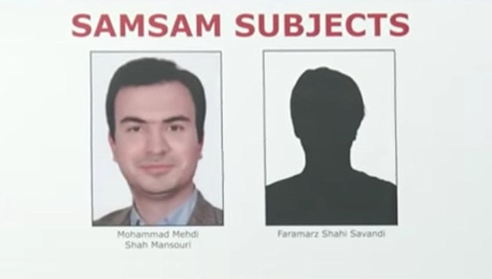 Prosecutors say Faramarz Shahi Savandi and Mohammad Mehdi Shah Mansouri created ransomware that encrypted data on the computers of more than 200 victims. The government alleges the hackers specifically targeted public agencies. (AP image from video)