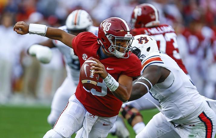 Alabama quarterback Tua Tagovailoa escapes pressure from Auburn defensive lineman Marlon Davidson during the first half of their game Saturday, Nov. 24, 2018, in Tuscaloosa, Ala. (Butch Dill/AP)