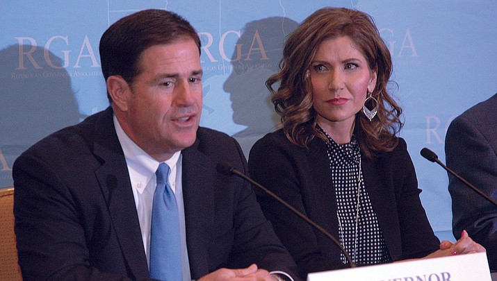 Arizona Gov. Doug Ducey answers questions from reporters Wednesday with Kristi Noem, the governor-elect of South Dakota, looking on. (Capitol Media Services photo by Howard Fischer)
