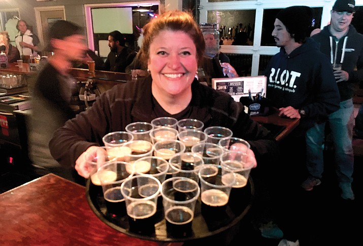 Jet Foley brings out a tray of DeschutesBrewery beer for a tasting during beer school on Tuesday at the Riot. VVN/Vyto Starinskas