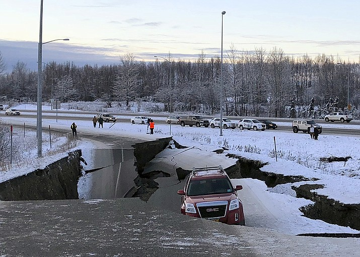 A car is trapped on a collapsed section of the offramp of Minnesota Drive in Anchorage, Friday, Nov. 30, 2018. Back-to-back earthquakes measuring 7.0 and 5.8 rocked buildings and buckled roads Friday morning in Anchorage, prompting people to run from their offices or seek shelter under office desks, while a tsunami warning had some seeking higher ground. (Dan Joling/AP)