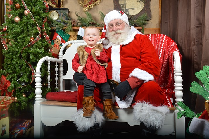 Children of all ages may pose for a photograph with Santa at Candy's Creekside Cottage. From 10 a.m. until 4 p.m. Dec. 2 and Dec. 16, meet Santa at the McGuireville shop. Photo courtesy of Candy Hammond