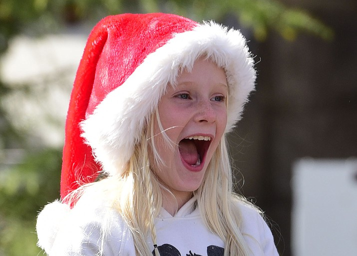 Kinsley Alexander from Peoria was excited as 90 floats, marching bands and special groups participate in the 38th annual Prescott Chamber Christmas Parade in downtown Prescott Saturday, Dec. 1, 2018. (Les Stukenberg/Courier)