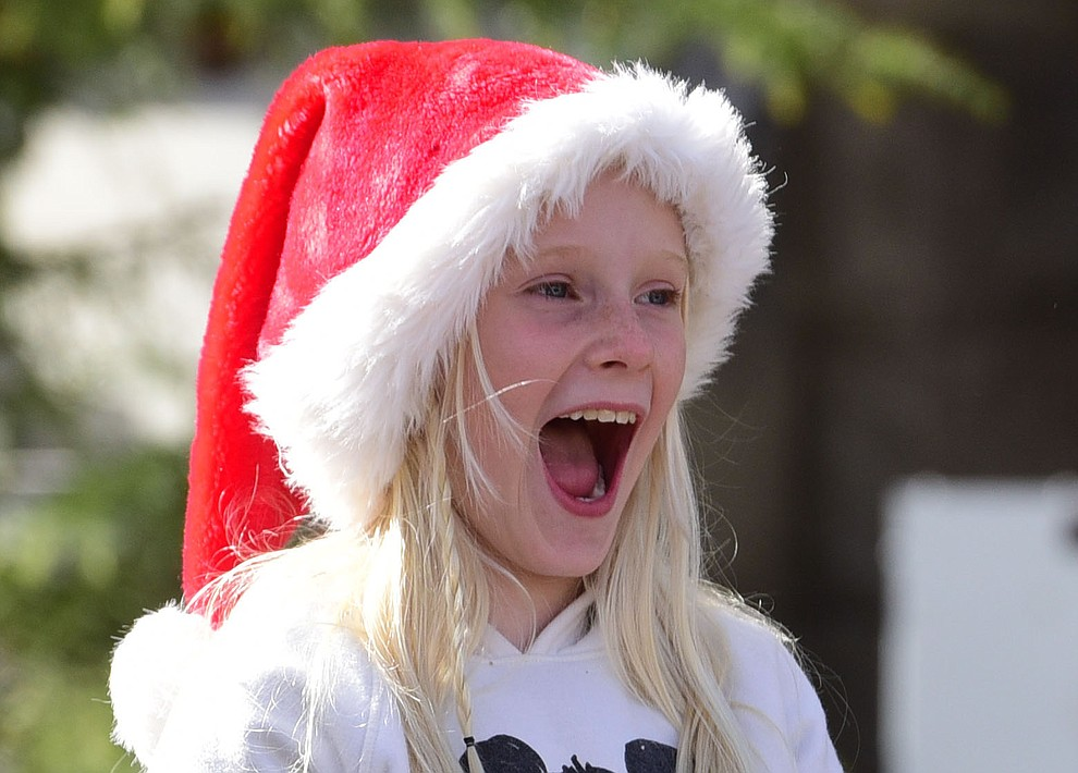 Kinsley Alexander from Peoria was excited as ninety floats, marching bands and special groups participate in the 38th annual Prescott Chamber Christmas Parade in downtown Prescott Satuday, Dec. 1, 2018. (Les Stukenberg/Courier).