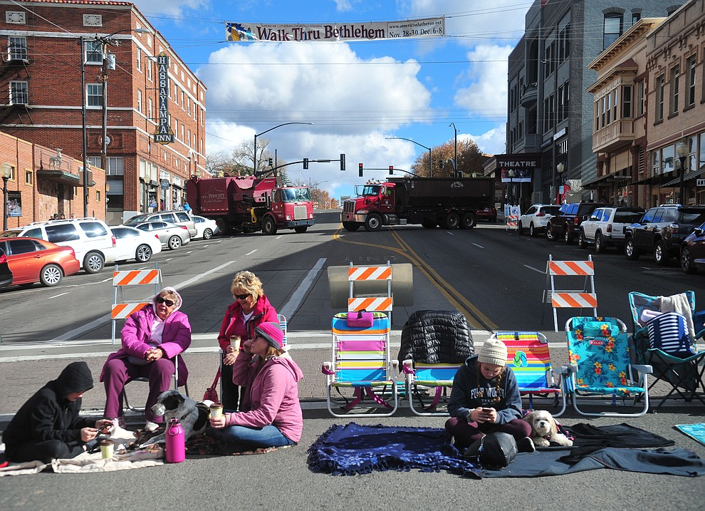 People came early to stake out their spot as ninety floats, marching bands and special groups participate in the 38th annual Prescott Chamber Christmas Parade in downtown Prescott Satuday, Dec. 1, 2018. (Les Stukenberg/Courier).