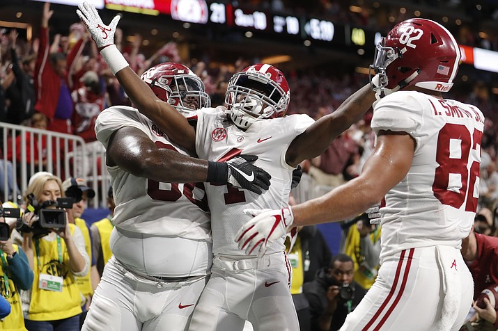 Alabama wide receiver Jerry Jeudy (4) celebrates his touchdown against Georgia during the second half of the Southeastern Conference championship NCAA college football game, Saturday, Dec. 1, 2018, in Atlanta. (John Bazemore/AP)