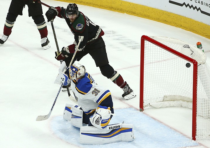 St. Louis Blues goaltender Chad Johnson (31) gives up a goal to Arizona Coyotes' Jakob Chychrun as Coyotes center Alex Galchenyuk (17) looks on during the first period of an NHL hockey game, Saturday, Dec. 1, 2018, in Glendale. (Ross D. Franklin/AP)