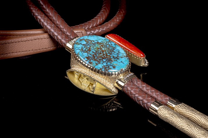 """Anasazi Village Bola Tie"" by Alvin Yellowhorse, 18k gold, diamonds, Candelaria turquoise, Mediterranean Coral and leather, bola: 2-1/2"" x 2-5/8"" x 3/4"". At Turquoise Tortoise, a Bryant Nagel Gallery in Sedona."