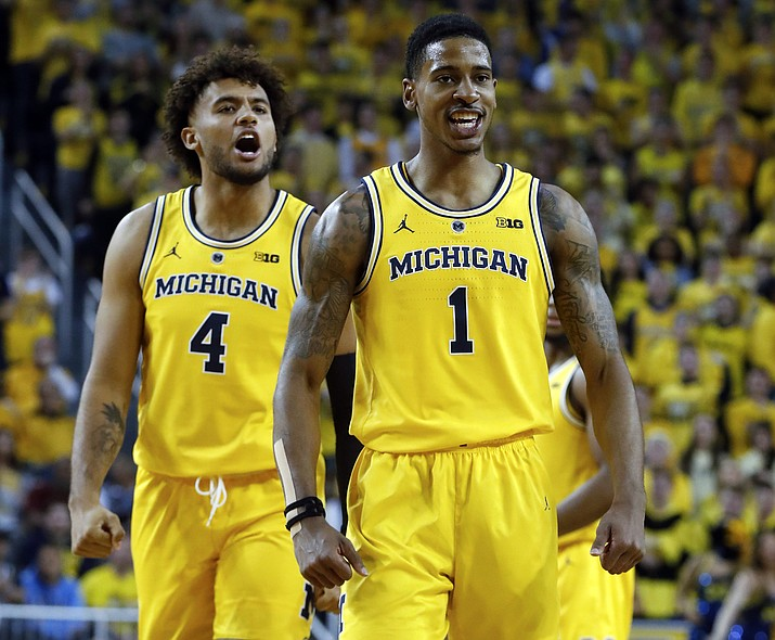 Michigan guard Charles Matthews (1) celebrates after being fouled while dunking against North Carolina in the second half of an NCAA college basketball game in Ann Arbor, Mich., Wednesday, Nov. 28, 2018. (Paul Sancya/AP)