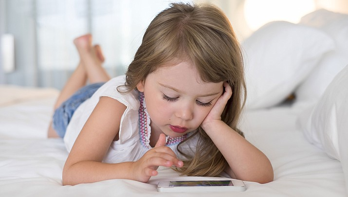 Last year, the American Academy of Pediatrics changed its recommendations: No more than one hour of screen time for children ages 2 to 5; for older children and teens, they caution against too much screen time, but there's no specific time limit. This study suggests that specific time limits on screen time are justified for preschoolers, it also makes the case for screen time limits for school-age children and teens. (Adobe Image)