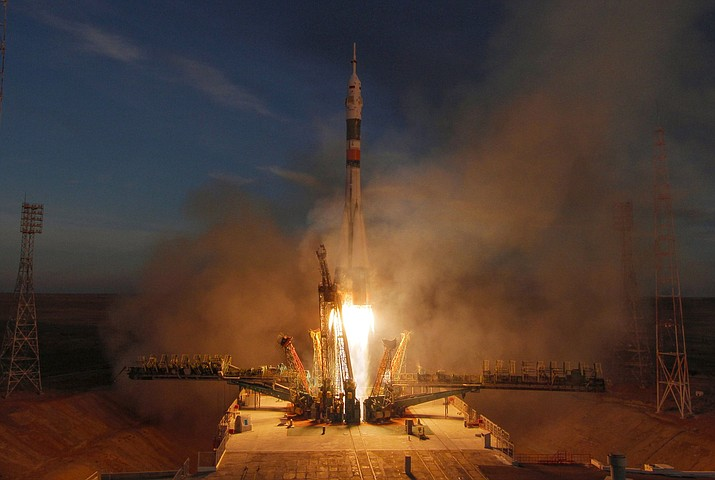 The Soyuz-FG rocket booster with Soyuz MS-11 space ship carrying a new crew to the International Space Station, ISS, blasts off at the Russian leased Baikonur cosmodrome, Kazakhstan, Monday, Dec. 3, 2018. The Russian rocket carries U.S. astronaut Anne McClain, Russian cosmonaut Оleg Kononenko and CSA astronaut David Saint Jacques. (AP Photo/Dmitri Lovetsky)