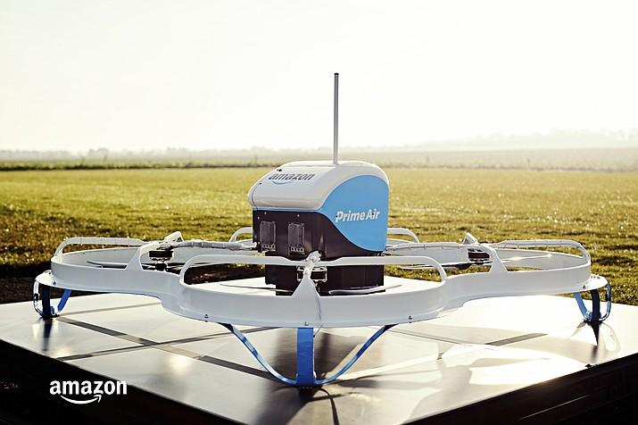 "This Dec. 7, 2016, file photo provided by Amazon shows an Amazon Prime Air drone in Cambridgeshire, United Kingdom. Amazon founder and CEO Jeff Bezos might have underestimated regulatory obstacles and privacy concerns when he told CBS' ""60 Minutes"" in December 2013 that his company would be making drone-borne deliveries within five years. (Amazon via AP, File)"