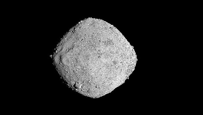 This Nov. 16, 2018, image provide by NASA shows the asteroid Bennu. After a two-year chase, a NASA spacecraft has arrived at the ancient asteroid Bennu, its first visitor in billions of years. The robotic explorer Osiris-Rex pulled within 12 miles (19 kilometers) of the diamond-shaped space rock Monday, Dec. 3. The image, which was taken by the PolyCam camera, shows Bennu at 300 pixels and has been stretched to increase contrast between highlights and shadows. (NASA/Goddard/University of Arizona)