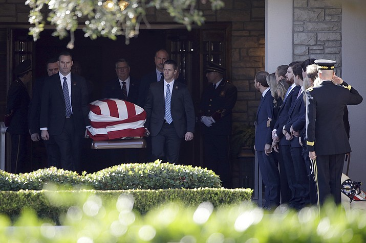 Members of the U.S. Secret Service carry the casket with former President George H. W. Bush to a hearse at George H. Lewis Funeral Home after a family service, Monday, Dec. 3, 2018, in Houston. Monday, Dec. 3, 2018, in Houston. (Kiichiro Sato/AP)