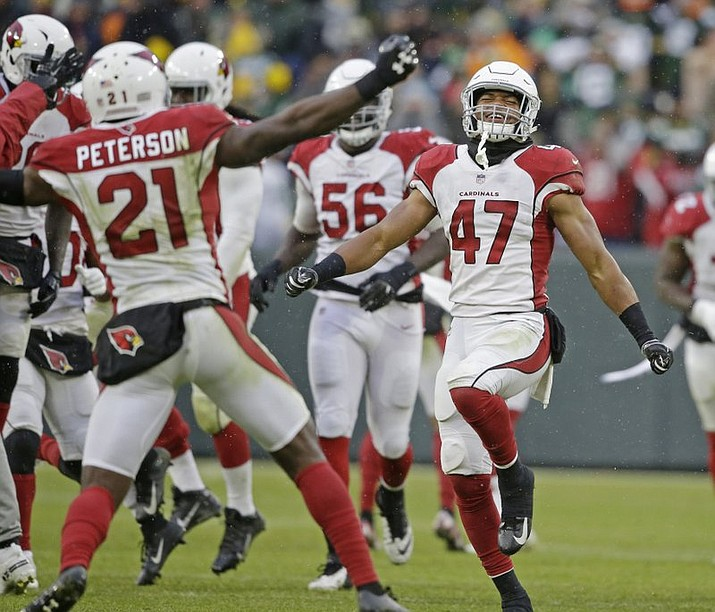 Arizona Cardinals players celebrate a win after a last minute missed field goal by the Green Bay Packers during the second half Sunday, Dec. 2, 2018, in Green Bay, Wis. Arizona won 20-17. (AP Photo/Jeffrey Phelps)