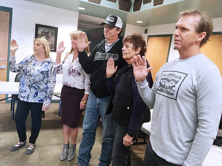 From left, Linda Welsch, Brandi Bateman, Justin Largent, Carol Keeton and Steve Darby take a ceremonial oath of office Monday to be the first board of the Copper Canyon Fire and Medical District. VVN/Bill Helm