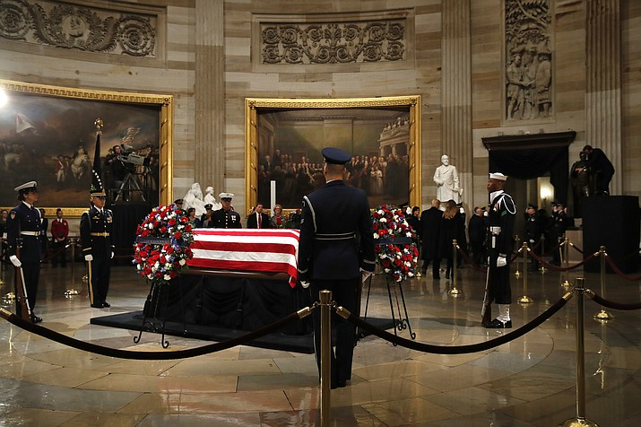 President Donald Trump and first lady Melania Trump leave the Rotunda of the U.S. Capitol after paying their respects to former President George H. W. Bush, Monday, Dec. 3, 2018, in Washington. (AP Photo/Jacquelyn Martin)