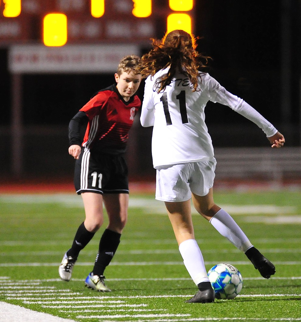 Bradshaw Mountain's Michelle Howe defends as the Bears host Cortez in girls soccer Wednesday, Dec. 4, 2018 in Prescott Valley. (Les Stukenberg/Courier).