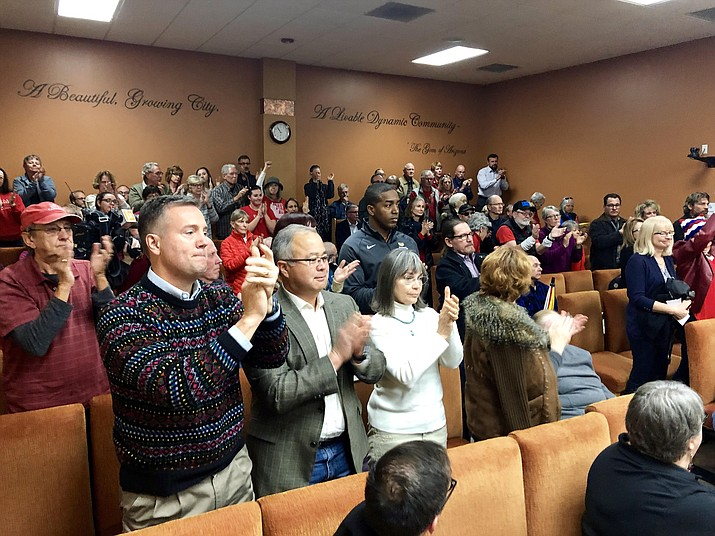 Members of the community stand and clap during a discussion Tuesday, Dec. 4, 2018, in Prescott, where the Prescott City Council voted 6-1 in asking for the resignation of State Rep. David Stringer and condemning his recent racial comments. (Cindy Barks/Courier)