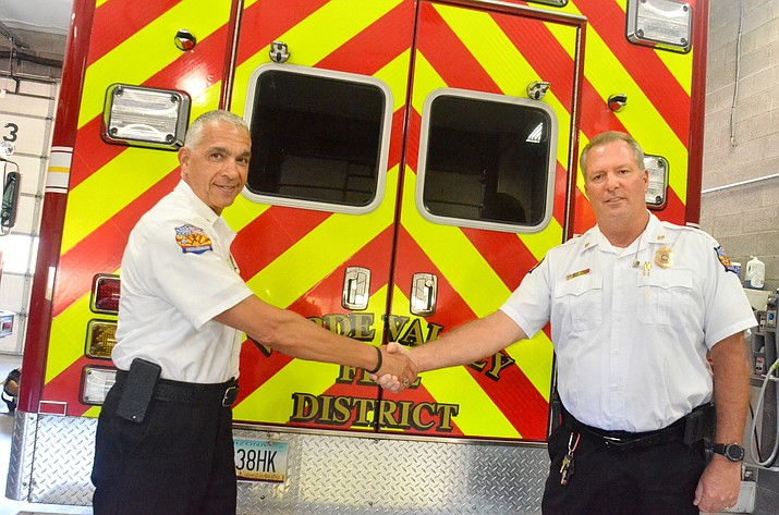 Joe Moore, right, shakes hands with former Verde Valley Fire Chief Nazih Hazime