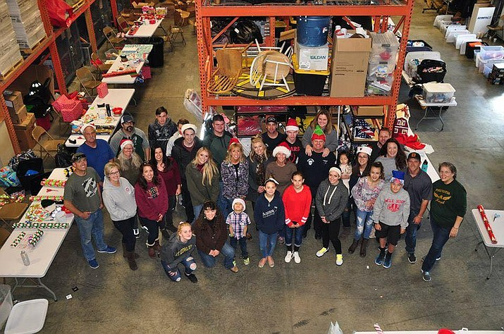 Firefighters and volunteers associated with the Firefighter Angel Foundation spent a portion of their weekend wrapping gifts that will go to children in need the week of Christmas. (Max Efrein/Courier)