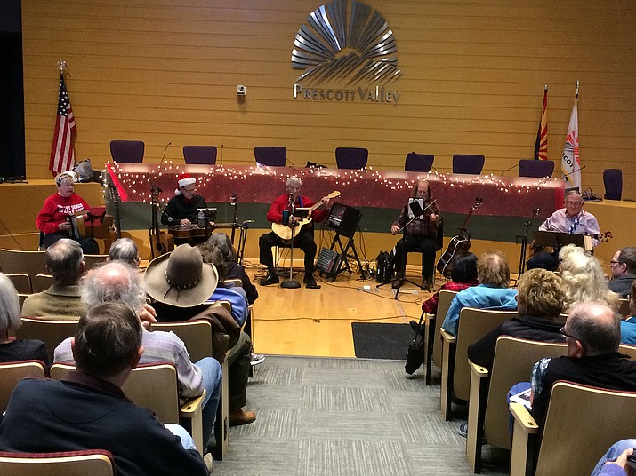 The Gadabouts perform country, folk, bluegrass and old-time mountain music for an audience of about 70 in the Prescott Valley Public Library on Friday, Nov. 30, 2018. (Sue Tone/Tribune)