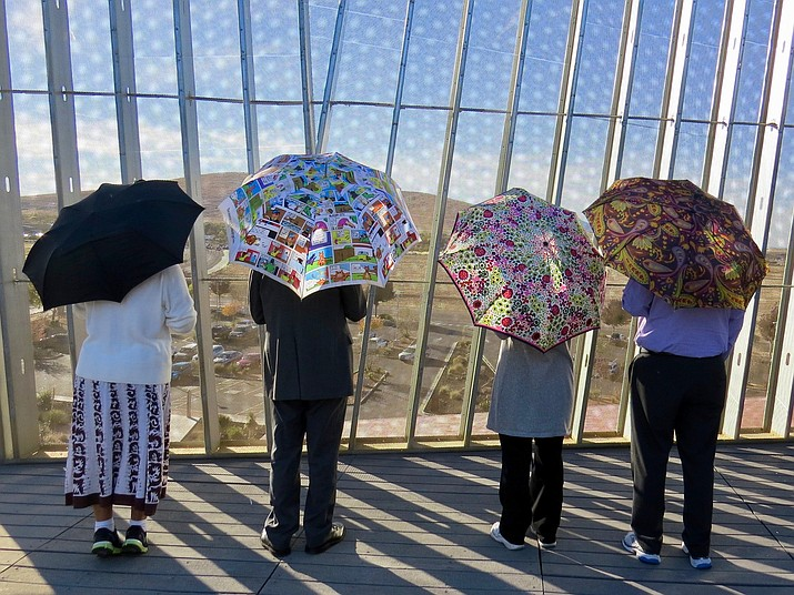 """One of the team selfie """"exercises"""" for employees participating in the Moving Through the Holidays Challenge is to take selfies of team members at specific locations around the Civic Center, such as these taken on the roof of the library. Team Wham and MLWA — Make Legal Walk Again — pose in the November sunshine. (Town of Prescott Valley/Courtesy)"""