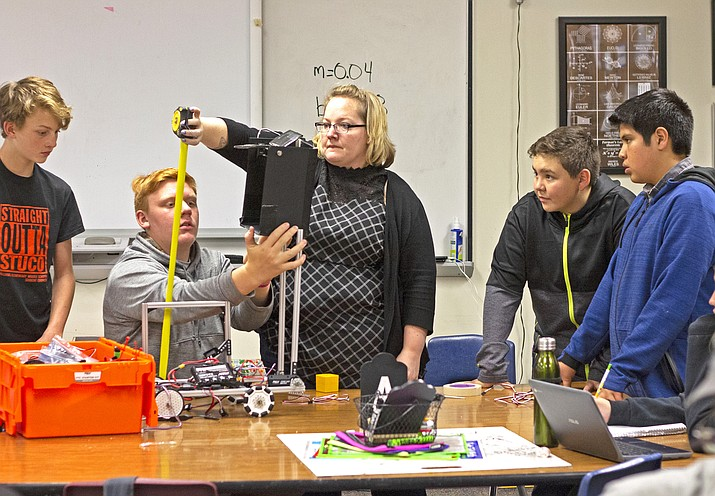 Donya Hadder leads her First Tech Challenge students as they work on their robot in the after-school robotics program.