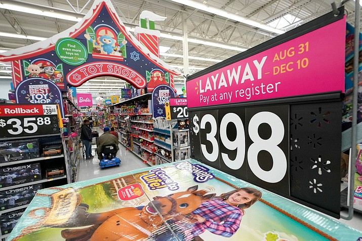 In this Nov. 9, 2018, file photo toys are displayed at a Texas Walmart Supercenter. A Secret Santa at a Walmart in Kennett Square, Pennsylvania near Philadelphia paid off nearly $30,000 worth of layaways. (AP Photo/David J. Phillip, File)