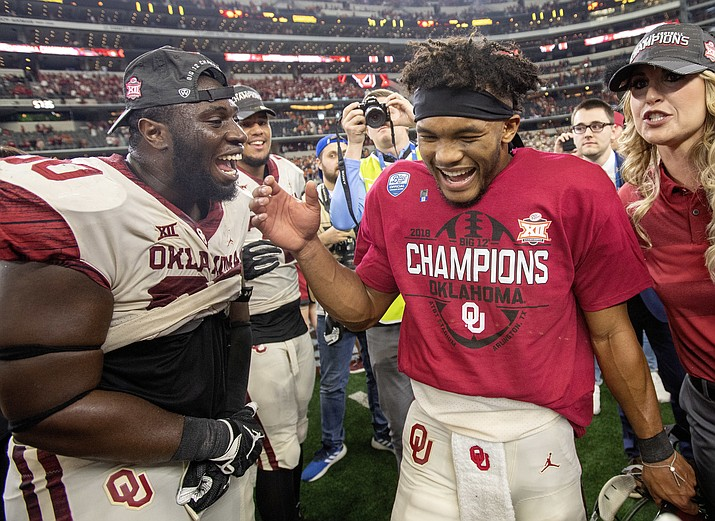 Oklahoma quarterback Kyler Murray, right, celebrates with teammate Neville Gallimore after beating Texas 39-27 in the Big 12 Conference championship NCAA college football game on Saturday, Dec. 1, 2018, in Arlington, Texas. (Jeffrey McWhorter/AP)