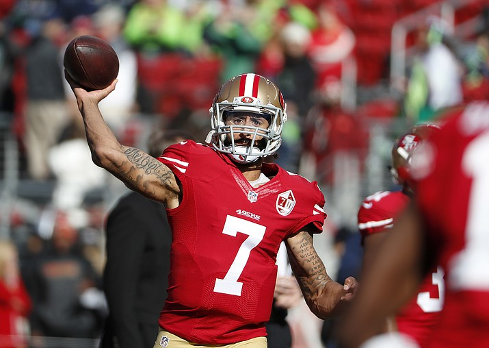 """In this Jan. 1, 2017 file photo, San Francisco 49ers quarterback Colin Kaepernick (7) warms up before a game against the Seattle Seahawks in Santa Clara, Calif. Washington Redskins coach Jay Gruden says the team """"talked about and discussed"""" bringing in Kaepernick for a tryout """"but we will probably go in a different direction."""" (Tony Avelar/AP, file)"""