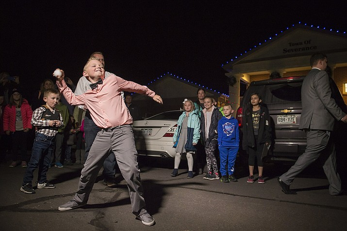 Range View Elementary School third grader Dane Best throws the first legal snowball in the parking lot of the Town Hall after presenting his argument to the town board trustees to change a law in Severance that bans snowball fights on Monday, Dec. 3, 2018, at the Town Hall in Severance, Colo. The board earlier voted unanimously to approve the law change. (Timothy Hurst/The Coloradoan via AP)
