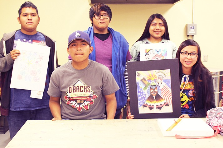 Hopi High students Marcus Brady, Miguel Saufkie, Simone Kuyvaya, Ethan Dawasevaya and Tanisha Wilson display their artwork they presented at the Arizona State Fair. (Stan Bindell/NHO)